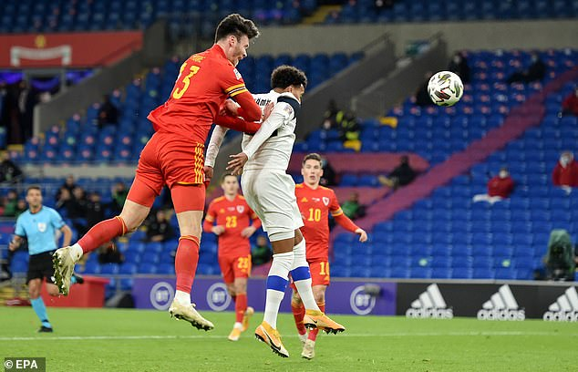 Kieffer Moore (L) of Wales scores his team's third goal of the game in the final 10 minutes