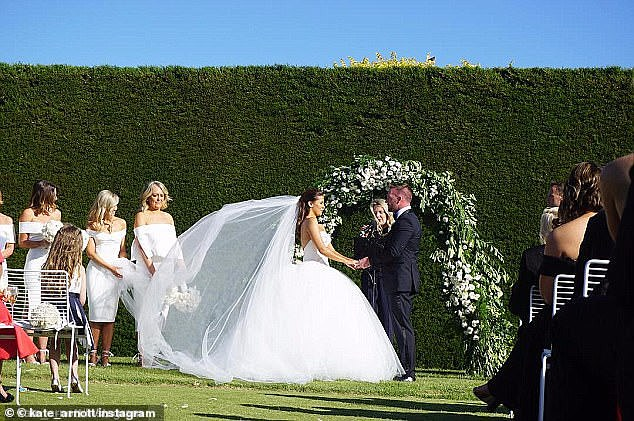 Going all out:The Weekend Today presenter carried a white floral bouquet and completed her look with a long tulle veil