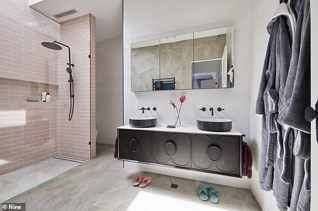 Pretty in pink! The pair carried on with the pink bathroom theme and tiled the shower walls pink. The judges described the pink guest en suite as 'divine'