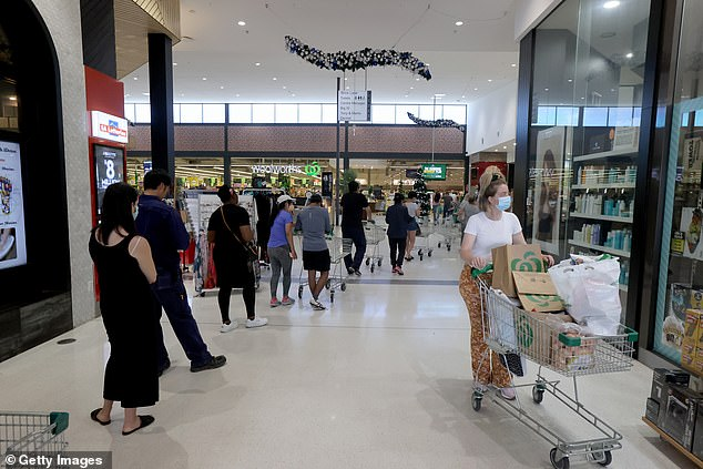 The six-day period is expected to be followed by another eight days of continuing restrictions (pictured, queues in Adelaide on Wednesday)