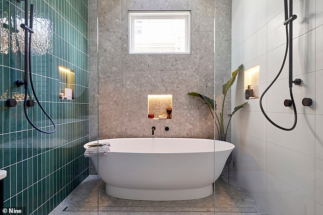 Wouldn't mind a soak in there! The colourful theme is carried onto the master en suite which is finished with a statement white bathtub and green tiles