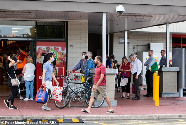 The harsh lockdown will see all schools will close along with universities, pubs, cafes, food courts and takeaway outlets (Adelaide residents lining up at Coles pictured above)