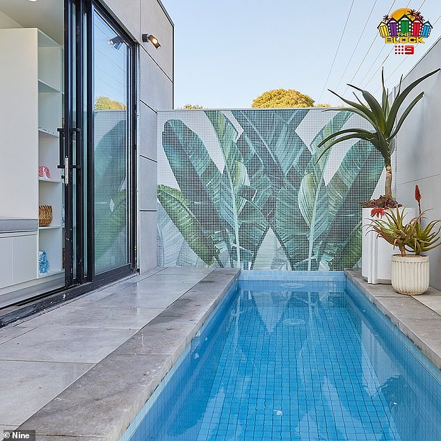 Holiday vibes: Pictured is their pool area and stunning mosaic tile design