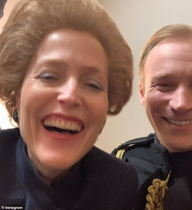 Candid: Another snaps sees Gillian Anderson full of beans with one of the queen's household, played by Sam Phillips