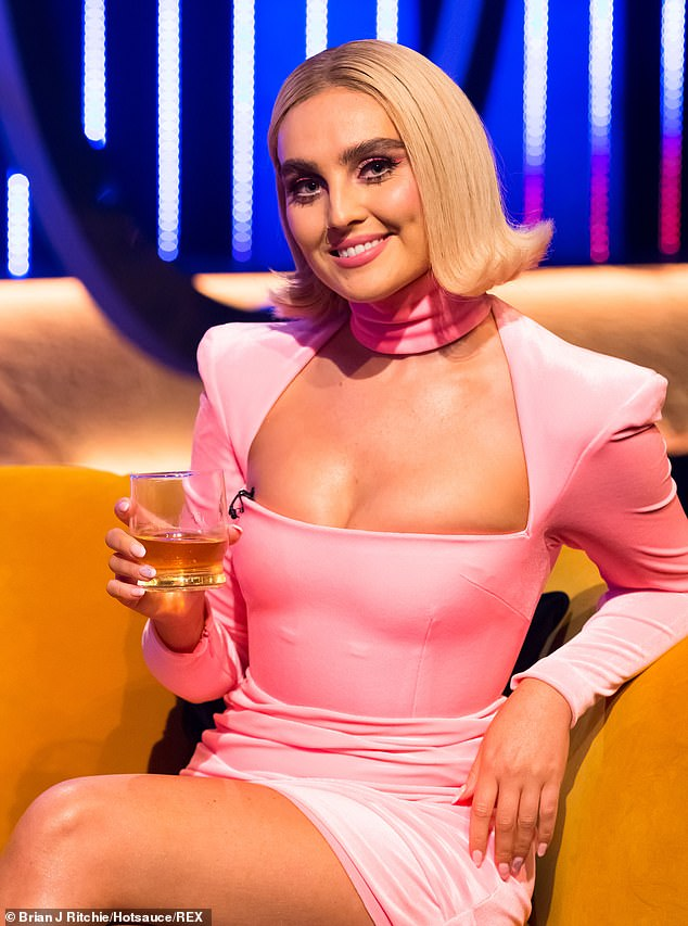 Candid: Perrie says: 'I don't think we expected it to be this hard; When you're young and you think of being a popstar, you think, ''Oh I want everyone to love me and ask for my autograph¿'' then you get thrown into it and you're like, 'Holy s*** balls it's a lot'