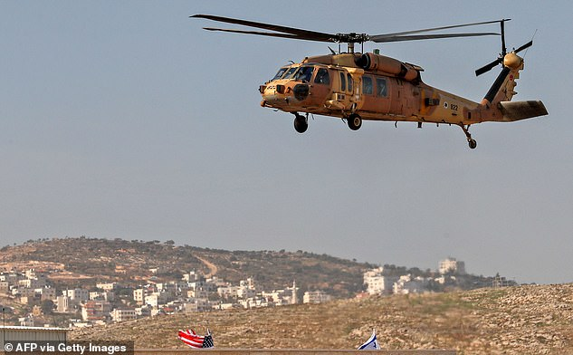 An Israeli airforce Blackhawk helicopter carrying Secretary of State Mike Pompeo hovers over Psagot Winery in the settlers industrial park of Sha'ar Binyamin