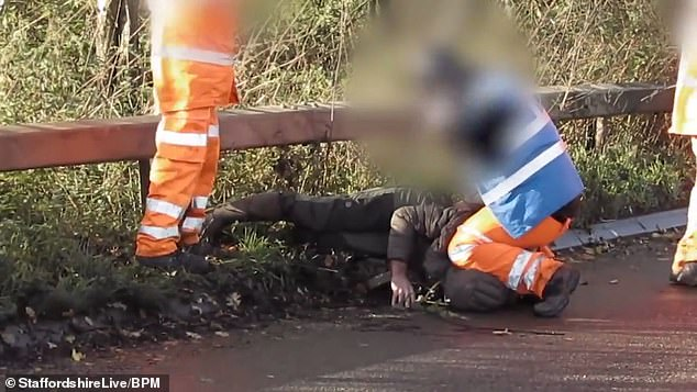 A HS2 worker has been filmed kneeling on the neck of a protester who was allegedly catapulting carrots into a work site of the high-speed rail scheme