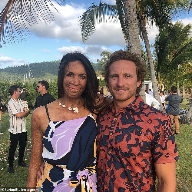 Ms Pitt said she was thinking about her now-fiancé Michael Hoskin when she was being 'burnt alive' during the horrific fire nine years ago (pictured together)