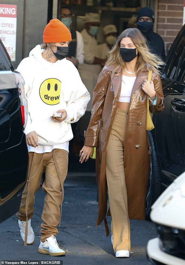 Superstar couple: Justin and Hailey Bieber were again seen out and about in Los Angeles on Thursday, this time leaving ritzy Italian eatery Il Pastaio in the Beverly Hills area