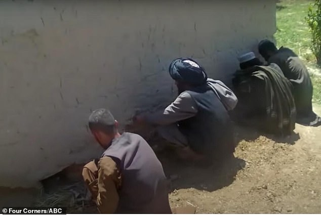Body cam footage shows prisoners by a wall during an Australian special forces operation in Afghanistan
