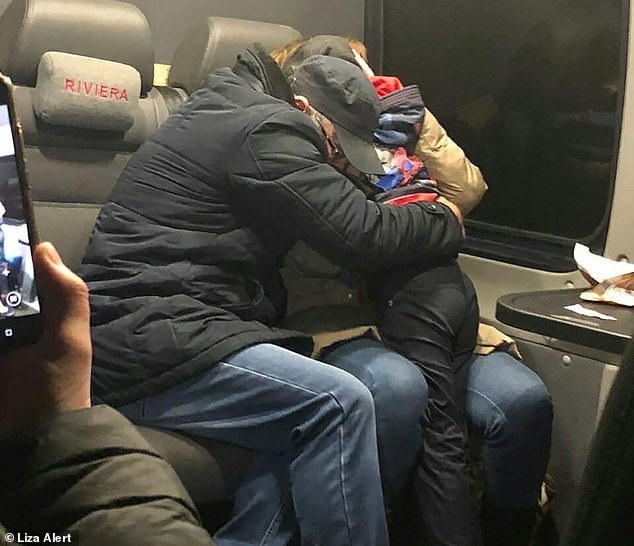 A seven-year-old boy hugs his parents after he was rescued 52 days after being abducted by an alleged paedophile as he walked home from school inGorki village, Vladimir region, Russia