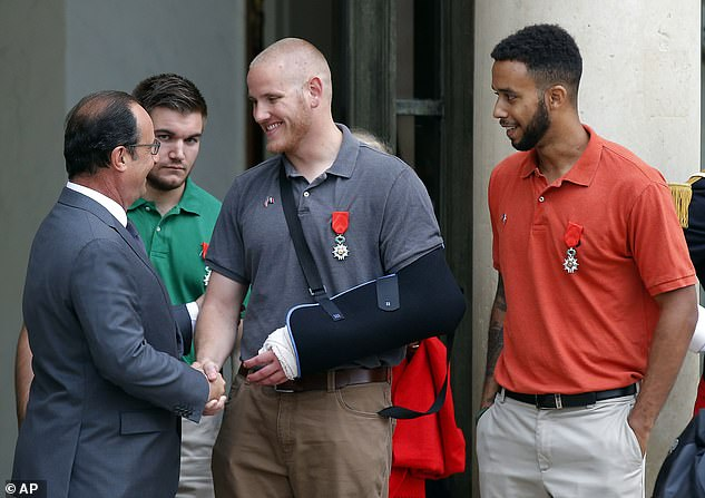 Spencer Stone (centre) who had been scheduled to appear as a star witness at the trial in Paris of Islamic State operative Ayoub El Khazzani, 31, was hospitalised Thursday in the French capital. Pictured:French President Francois Hollande congratualtes Stone, Alek Skarlatos (second from left) and Anthony Sadler (right) in 2015 after they foiled the attempted terror attackon the Amsterdam to Paris train