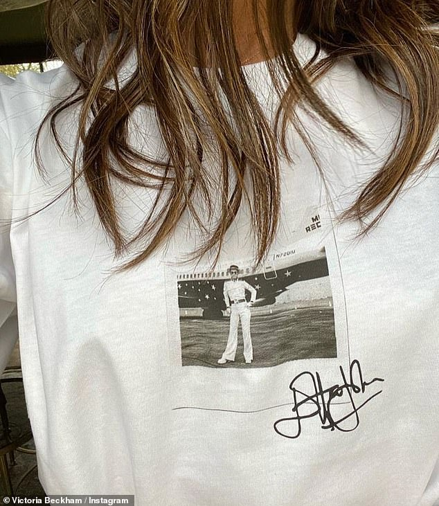 T-shirt: The singer-turned designer, 46, took to Instagram on Friday to share a snap of herself posing in the white top, which featured the black-and-white image of Elton