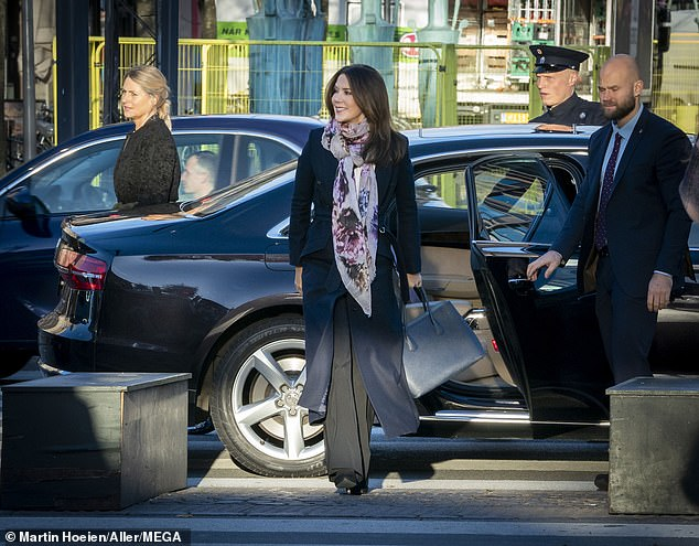 Well styled: The 48-year-old arrived at Tivoli Gardens in Copenhagen, Denmark, wearing a long navy coat by Danish brand FonnesBech and bright scarf