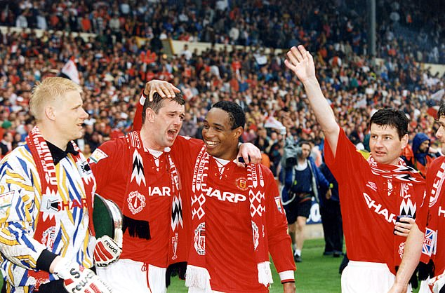 Pallister (second from left) after Manchester United's 1994 FA Cup final victory over Chelsea
