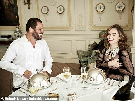 Covering: Lily held onto her bosom over her sheer black blouse as the duo shared a laugh