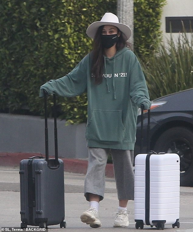 Moving out, moving on: Cara Santana was seen moving out of her Beverly Hills home on the border of the Sunset Strip in Los Angeles on Friday