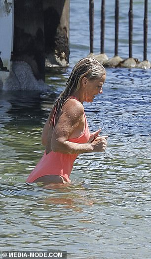 Looking good! The ex-wife of former cricketer Shane Warne appeared in high spirits as she splashed her muscular frame in the water at the popular sun-drenched hangout