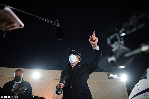 'I know you'd ask it,' Biden replied heatedly, wearing two masks. 'I have no response, it's another smear campaign, right up your alley, those are the questions you always ask'