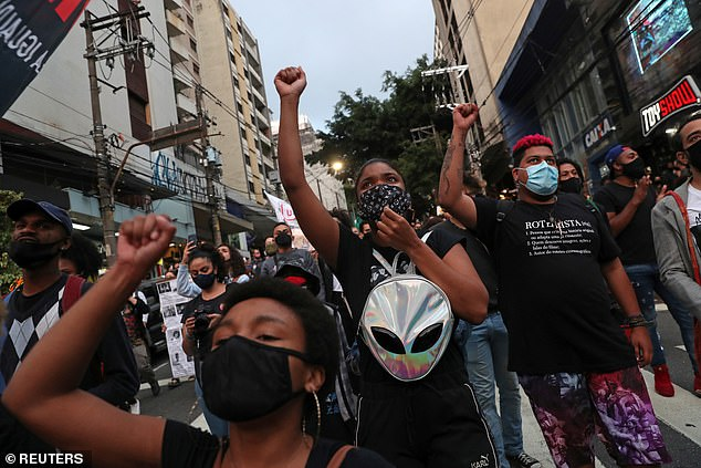 Demonstrators gesture during a march in Sao Paulo on National Black Consciousness Day and in protest against the death of Joao Alberto Silveira Freitas