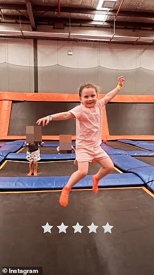 Jump to it: A smiling Kelsey Lee happily performed a series of somersaults in between jumping on the indoor trampolines