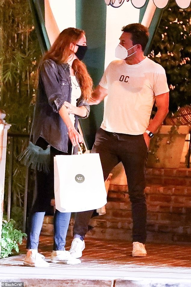 Outing:Jon Hamm, 49, and his Man Men co-star girlfriend Anna Osceola, 32, looked smitten as they headed home after a low-key dinner date in West Hollywood on Friday evening