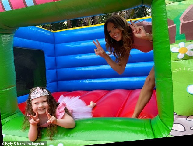 Adorable: Kelsey Lee and Kyly posed on the jumping castle hired for the day