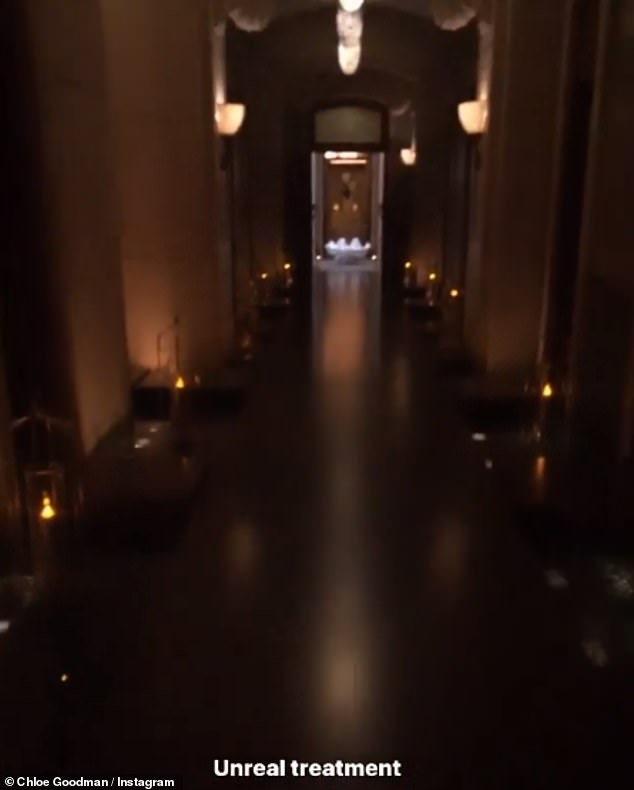 Pampering time:Chloe shared a glimpse of the dimly lit hallway as she declared their spa treatment as 'unreal'