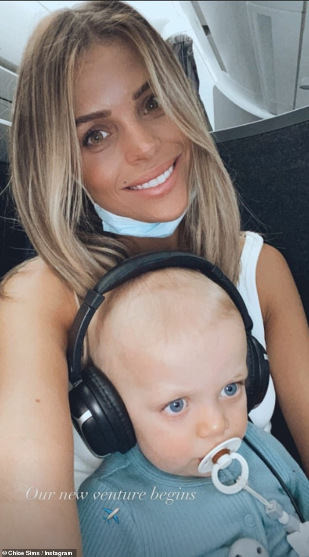 'Our new venture begins': Chloe also shared an adorable picture from her plane journey with her 13-month-old son Beau perched on her lap