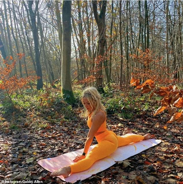 Autumnal scene:Gabby Allen, 27, flaunted her flexibility as she did yoga in the woods in London on Saturday