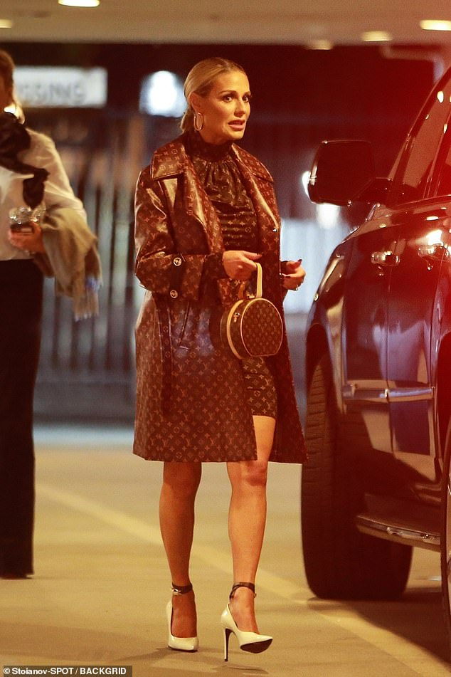 Loves a brand: Dorit Kemsley opted for head-to-toe Louis Vuitton in a blazer and minidress with the luxury brand's signature logo splashed across her body