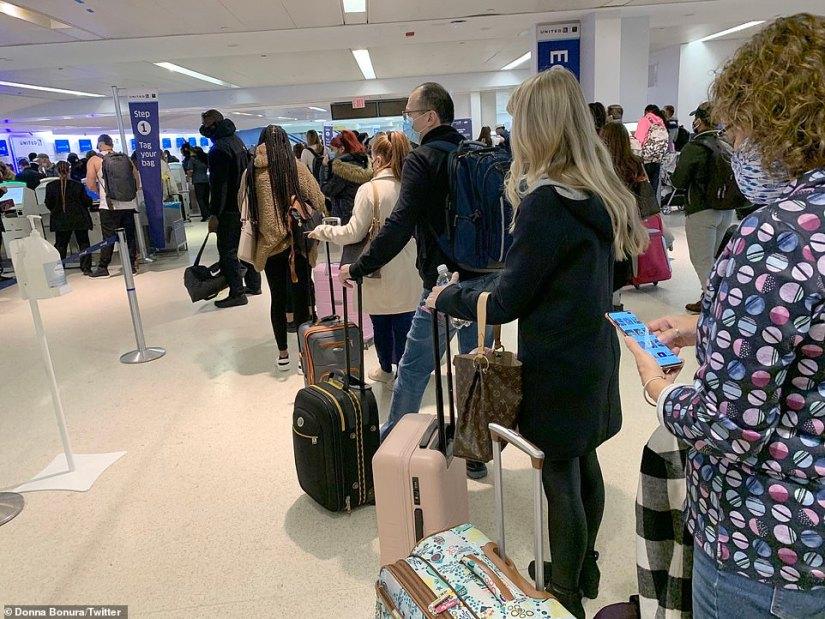 NEW JERSEY: Little social distancing was seen among passengers lining up at Newark Liberty International Airport on Sunday