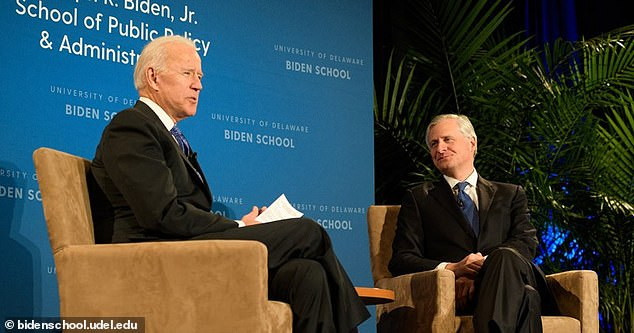 Meacham and Biden have had a close relationship over the years. They are pictured together above at thethe Joseph R. Biden, Jr. School of Public Policy and Administration at the University of Delaware