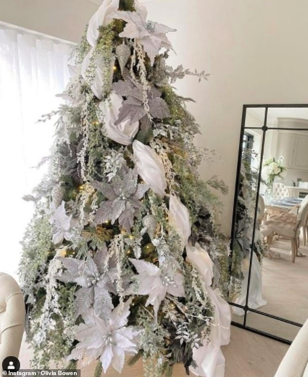 Magic in every room: Another tree inside the kitchen boasts stunning white decorations