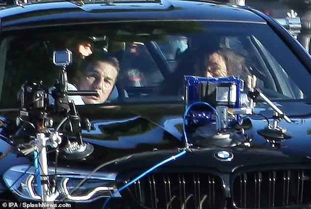Watch out: Tom appeared shocked as they shot the scene, ensuring to work all his angles for the cameras attached to the bonnet