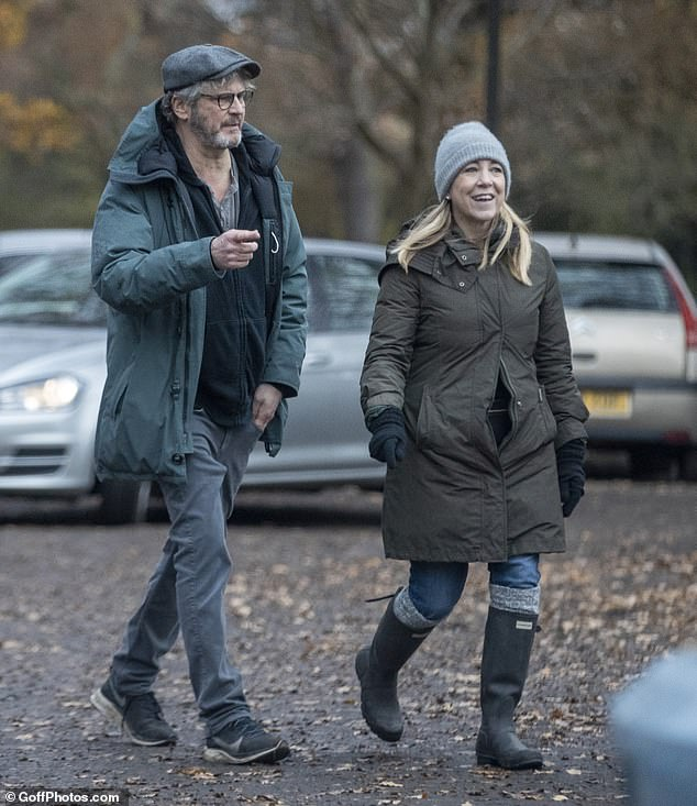 Winter stroll: Colin Firth appeared to be following a similar script to Bridget Jones in real life when he was spotted enjoying a relaxed stroll with news presenter Joanna Gosling last week