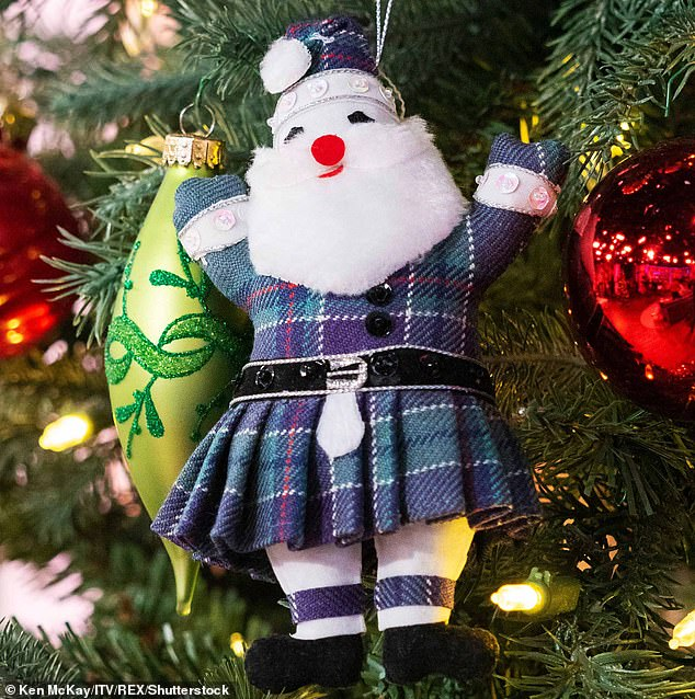 Christmas gift: Ms Sturgeon's traditional tree decoration. The Scottish First Ministercontacted producers to say she wanted to present the gift to Mr Holmes and his wife