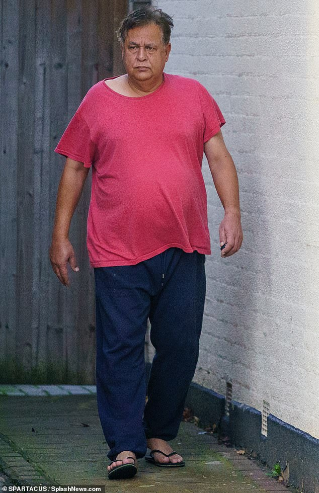 Heart surgeon Hasnat Khan, 62, who once had a discreet two-year relationship with Princess Diana, was spotted putting the bins out at his Essex home on Sunday
