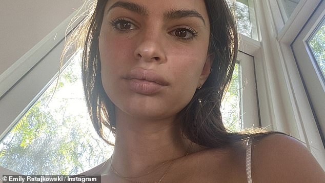 In your face: Looking a bit tired she showed off her extremely luscious lips as she posted a selfie