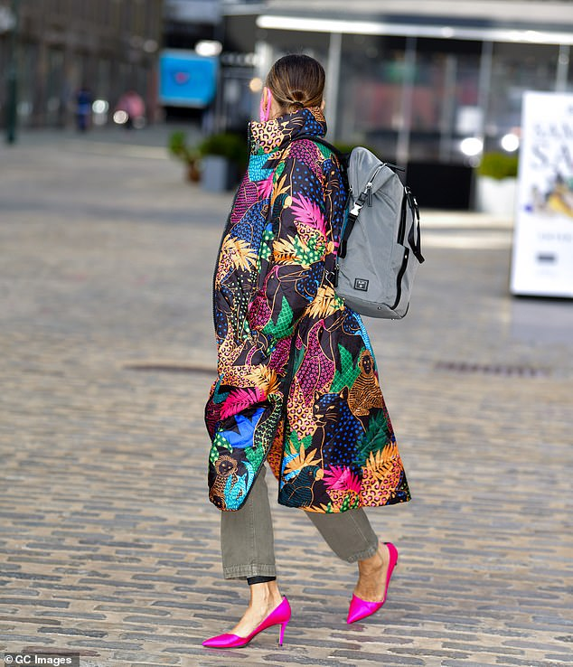 Wow factor:SJP rocked the same coat just two days prior, contrasting it beautifully with hot pink pumps and a matching face mask