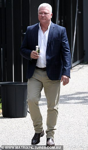 Everything OK? Scott wore a rather concerned expression as he strolled around set with an energy drink in his hand
