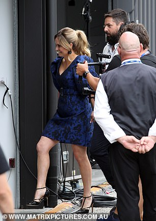 Stylish: Judge Shaynna Blaze was dressed to impress in a low-cut floral print navy blue dress