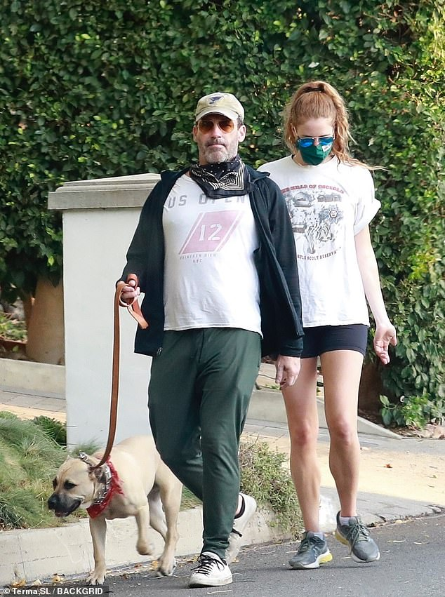 Dog walk Saturday: Jon Hamm appeared to be enjoying his Saturday with his girlfriend Anna Osceola, as the couple took their yellow lab pitbull mix for a walk near his home in Los Feliz