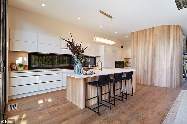 What a kitchen! In fact, this couple have become known on The Block for their love of curves in their designs. Their wooden and white kitchen features an ample amount of curved lines and was a hit with the judges