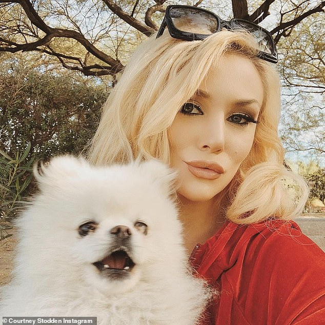 Four-legged family members: Stodden showcased her beloved Pomeranian pooch in another post that she captioned: 'Family portrait'