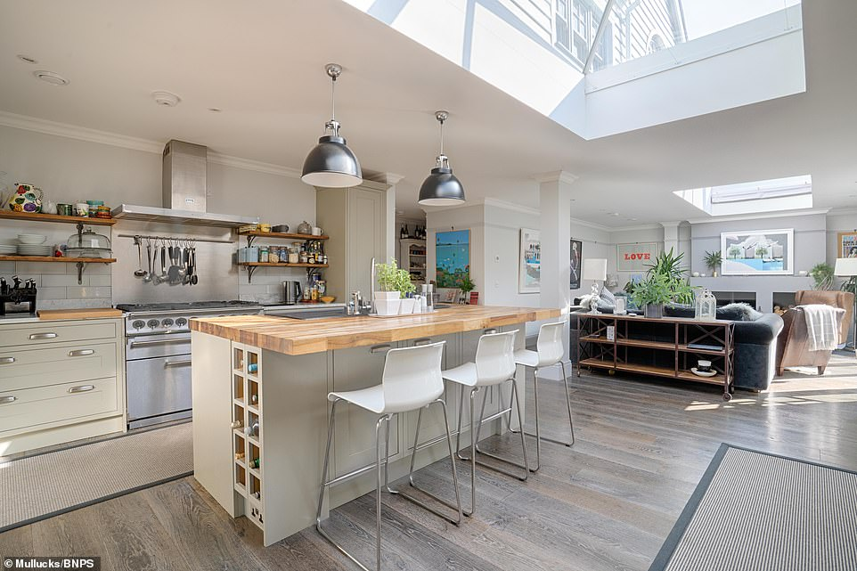 The house has 2,900 sq ft of living space over three floors. On the ground floor there is the large open plan kitchen