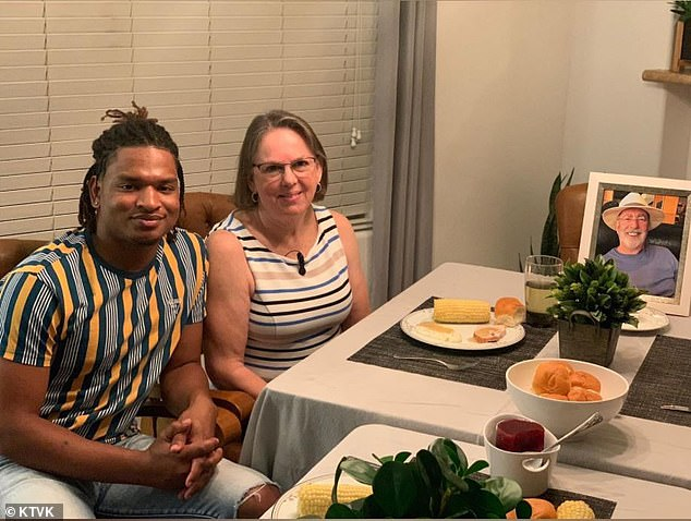 Wanda Dench, 63, and Jamal Hinton, 21, enjoyed an early Thanksgiving dinner on Friday - seven months after Dench's beloved husband passed away from COVID-19