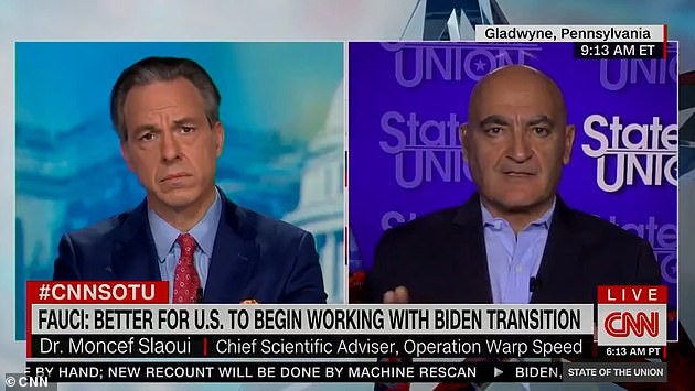 Operation Warp Speed head Dr Moncef Slaoui (right) spoke to CNN's Jake Tapper and said he believed on December 11 or 12 the first Americans could get vaccinated - and life could get back to normal by May