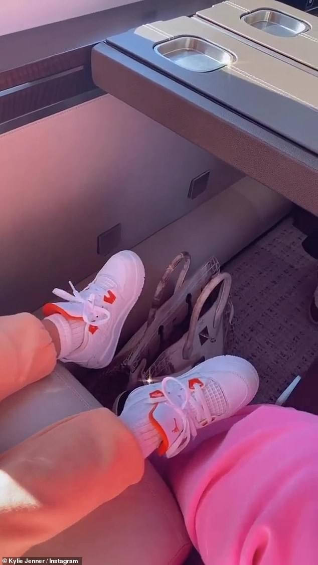 Where are they going? The 23-year-old shared this snap of Stormi's legs sat as they sat side-by-side on the plane