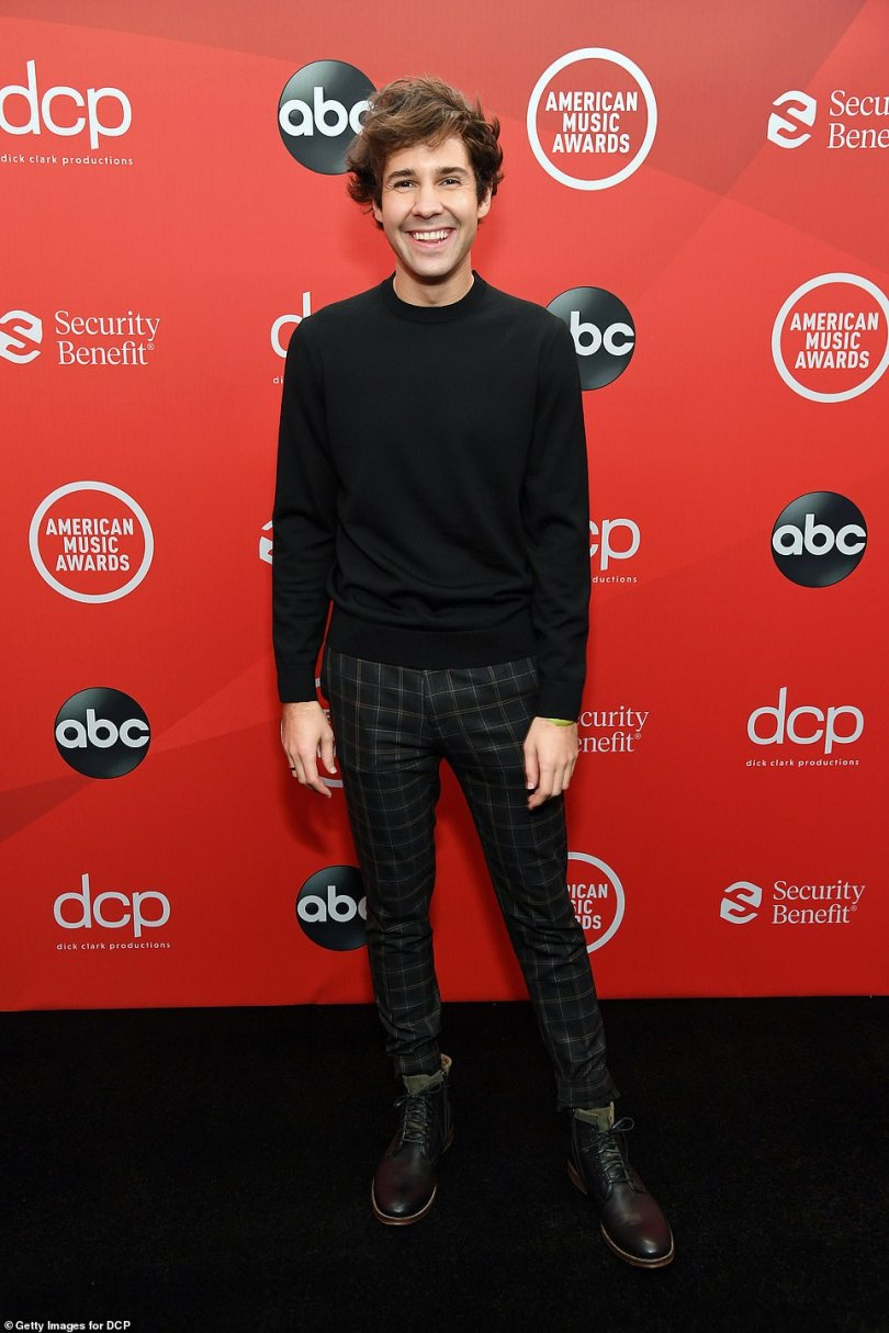 Grinning:YouTube star David Dobrik grinned from ear-to-ear as he took to the carpet solo on Sunday night